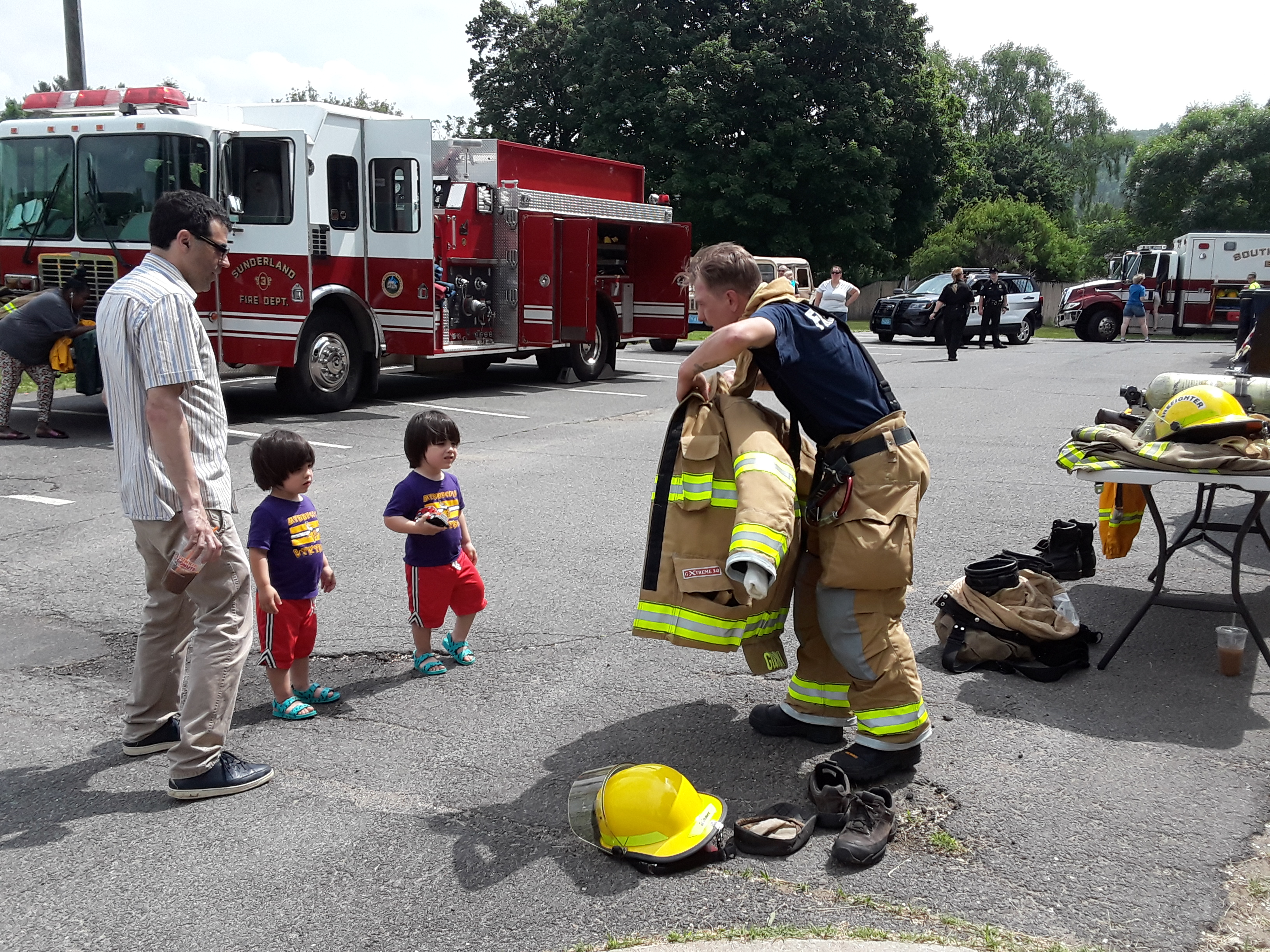Kids got to try on real fire fighter equipment during our 2018 Touch a Truck.